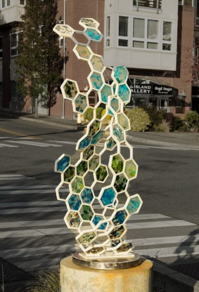Fossil II, vibrant glass and metal hexagon shaped sculpture
